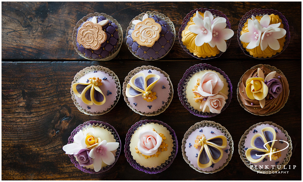 Selection of individually decorated, elegant cupcakes.